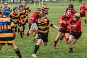 Dalby Wheatmen play the Highfields Redback under 12's at Highfields Sports Park last Saturday. Character-building rainy conditions